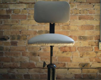 gray leather drafting stool by united