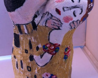 The Kiss original paper mache art sculpture