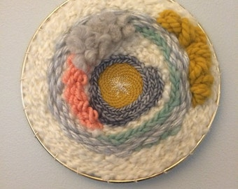 round abstract textural weaving - pastel woven wall hanging