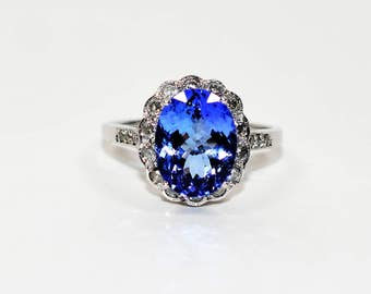 40% OFF SALE with free resizing!! Spectacular 4.10tcw D'Block Tanzanite & Diamond 14kt White Gold Ring