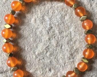 South American orange Jade semi precious 6mm gemstone bracelet with gold hematite.