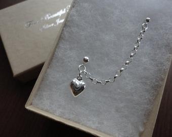 Puffed heart double piercing stud earring
