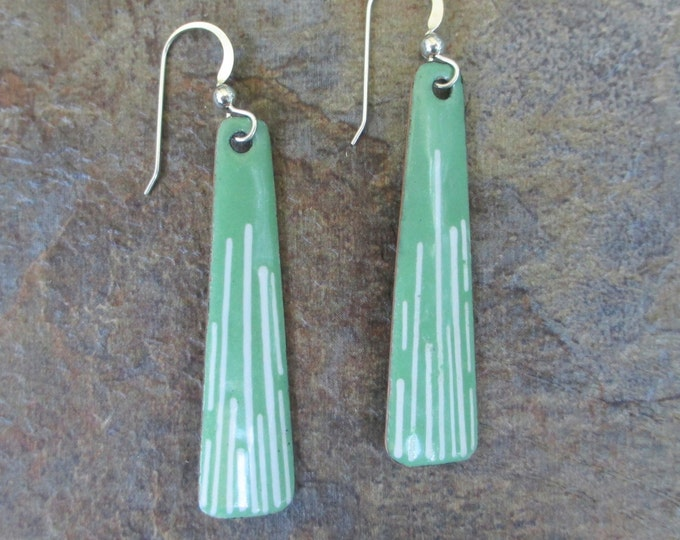 handmade green enamel earrings with white lines on a sterling silver ear wire.