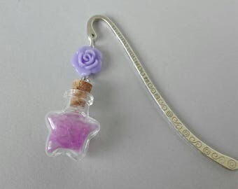 Metal and glass bookmarks filled with lilac feathers and crowned with a lilac rose