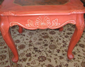 Asian inspired side table, painted in persimmon color, with frottage technique, trimmed in gold paint.