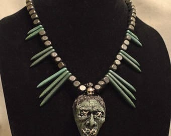 Shrunken Head Tiki Necklace - Moss Green