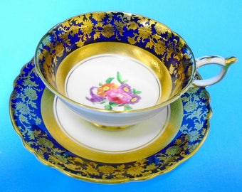 Paragon art deco gold etch gilt tea cup, pink rose cobalt blue tea cup and saucer