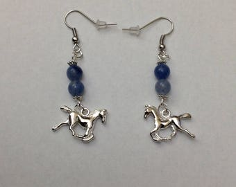 Mustang horse with blue earrings