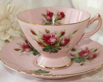 Westville, Japan:  Pink tea cup and saucer with beautiful dark pink roses