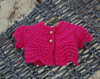 Hot Pink Doll Sweater and two others