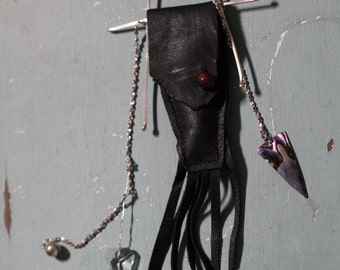 Leather Talisman Pouch or Medicine bag on adjustable cord and holding raw clear crystal