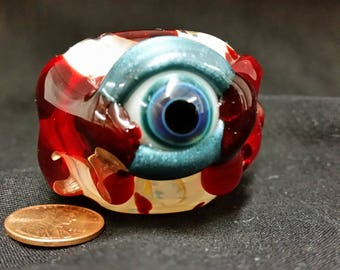 Inside out bloody eyeball spoon style pipe with color changing glass
