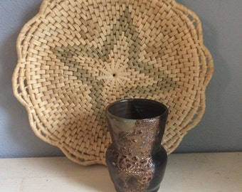 vintage, hand made, pottery vase, earth colours, with dark glaze, and iterating textures