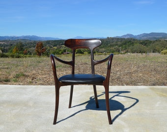 Mid Century Modern Inspired Rosewood Kagan Chair With Curved Arms and Black Leather Seat