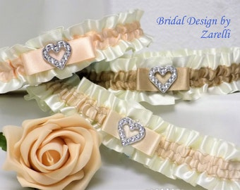 Wedding garter/Bridal garters. White/Ivory satin with 4 contrast trims & silver coloured heart. 'Something blue' added