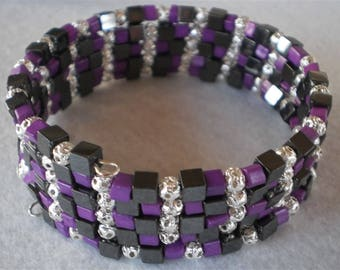 Bracelet of glass seed beads, metalic and hematites stones on memory wire, 5 rows, purple, black and silver