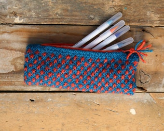 Blue and orange hand knitted pencil case