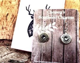 Sterling silver dangling bullet earrings