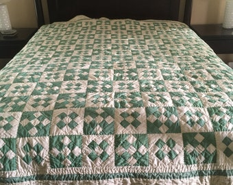Calming 9 patch queen sized quilt in green and off white