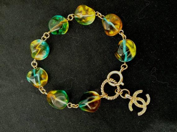 Vintage multi-tone large glass beads bracelet with beautiful authentic designer charm
