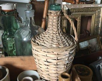 Vintage Viresa miniature Demi-John. Wicker basket covered green glass wine bottle.