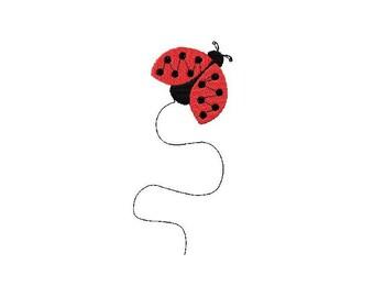 Machine embroidery flying ladybug