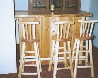Custom built bar with stools.