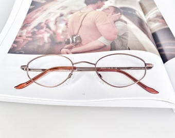 Authentic 1980's vintage, bronzed metal optical glasses frame