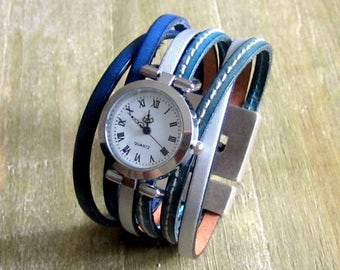 Shows blue/silver leather cuff, loving money 30MM plate clasp Bracelet