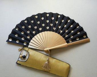 Fan and founded. Hand fan.