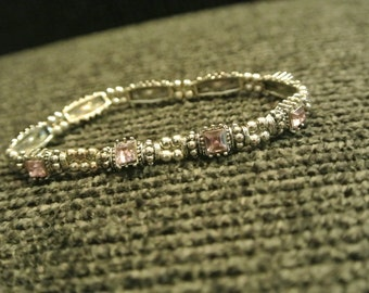 A Silvertone and Amethyst Crystal Stretch Bracelet
