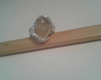 Pear shaped Rutilated quartz in Sterling silver ring with silver leaf motif.