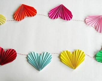 Paper hearts pendulum.