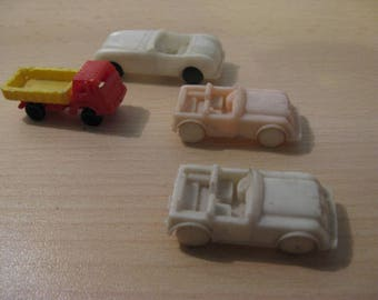 Four old plastic cars from the 1950s