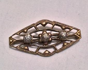 Lovely vintage metalwork and paste rhinestone brooch