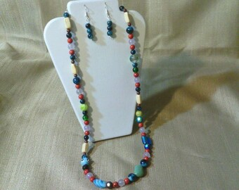 311 Gorgeous Magnesite Turquoise Center Bead, Red Sponge Coral Beads, Lamp Work Glass, Brown Clay Beads and Riverstone Beads Beaded Necklace