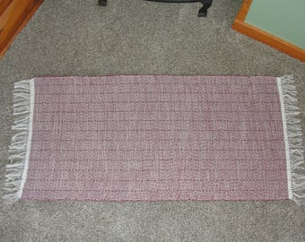 "Hand Woven Rag Rug Burgundy/Tan measures 25"" x 56"" incl. fringe Item# 295"