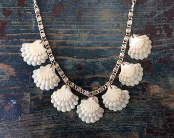 Vintage Retro Celluloid Sea Shell Charm Necklace - three graduated shells, gold tone fancy chain