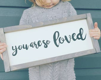 "Framed ""you are so loved"" sign"