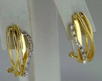 Earrings in yellow + white gold 14 ct, set with diamonds. size: 19.78 9.62 x mm