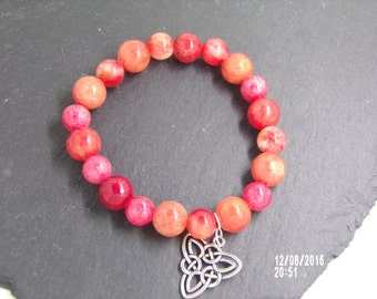 B1226 Coral Agate Bracelet With Celtic Trinity Charm.