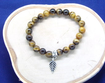B021719  Brown Ceramic Beaded Bracelet with Silver Leaf Charm.