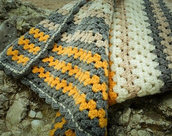 Crocheted granny striped throw