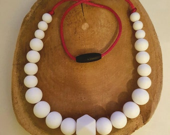 Chain for children with white silicone beads. Teething necklace. Stress release. Chewing. Safety closure. Chewelry. Teething necklace.