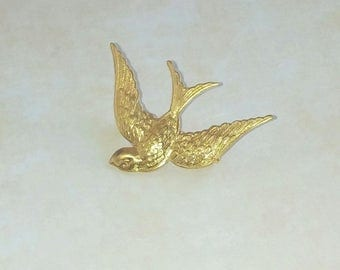 With Golden brass swallow brooch