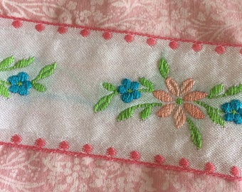 Pink and white floral bunting decorated with vintage decorative floral ribbon