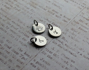 Add a charm, hand stamped initial, paw print, personalized jewelry