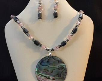 Multi-colored abalone shell pendant with glass and magnetic beads