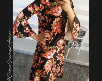 black and coloured flowers dress, calf lenght, bell sleeves.