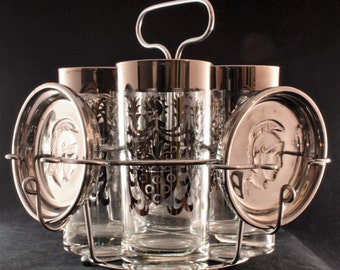 Vintage Kimiko Silver Tone Rimmed/Crest Design Highball Glasses with Embossed Centurion Bust Coasters in Caddy